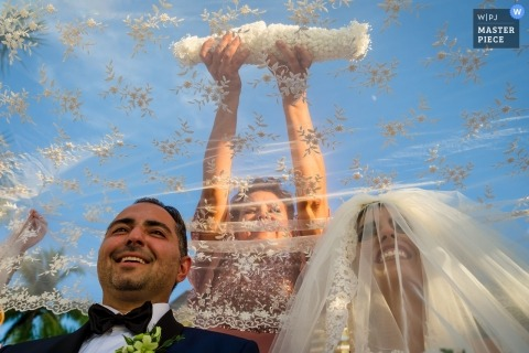 Puerto Vallarta couple during their wedding ceremony held outdoors under blue skies