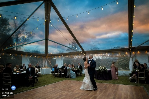 Knoxville wedding shoot with a couple during first dance under clear tented Tennessee reception