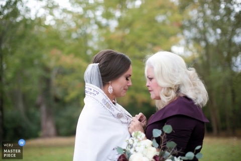 Knoxville documentary wedding photo of bride and mom sharing a moment before Tennessee ceremony