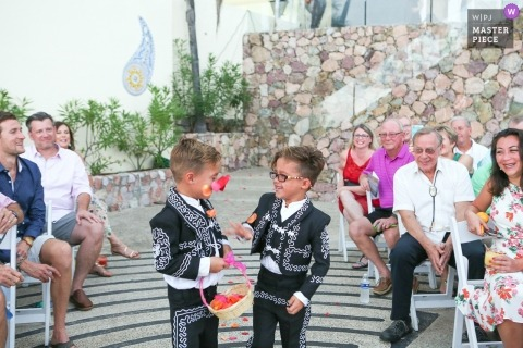 flower boys or ring bearers having a flower fight | kids at weddings in puerto vallarta, mexico