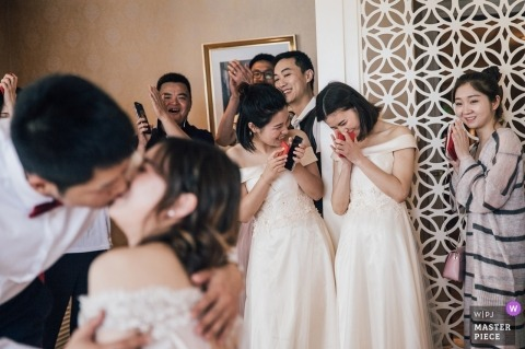 Pictures of a couple kissing by a top ChongQing wedding photographer