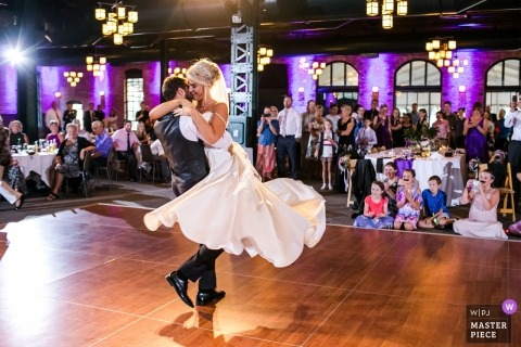 Documentary wedding photograph of dancing bride and groom at Chicago reception