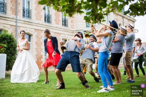 Hotel SPA du Chateau LAGORD, France | A bride dances with marching band