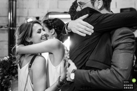 aix en provence documentary wedding photo of girls and guys hugging at the church