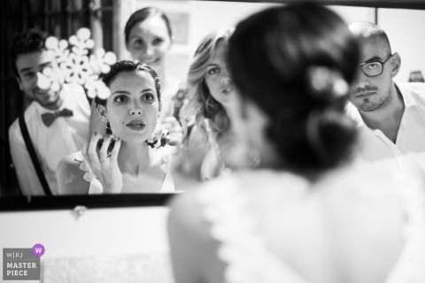 aix en provence wedding photo of bride checking makeup in mirror | getting ready wedding photography