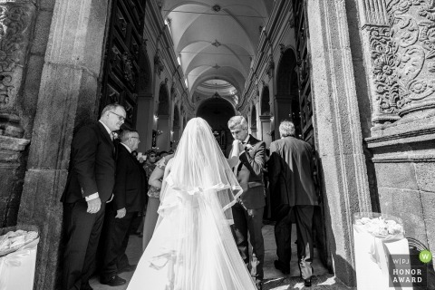 Sicilia wedding photo of father kissing bride's hand    wedding photography before church ceremony