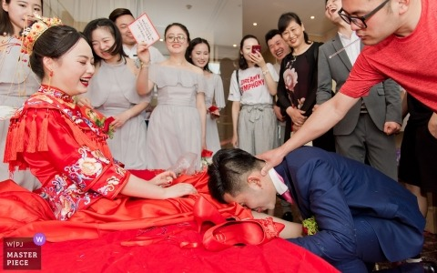 "Lintong District, Shaanxi Province, China | the groom put out his tongue and licked the bride's foot. The bride smiled and asked, ""How does it taste?"""