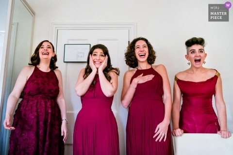 Bridesmaids react to bride in her dress at The Grove, Hertfordshire