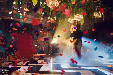 Mumbai wedding photo of couple on dance floor with confetti | India wedding photography