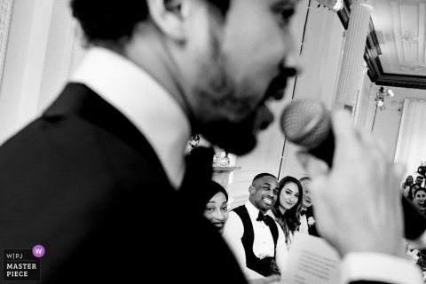 Pictures of a London, United Kingdom couple during speeches at their wedding reception party