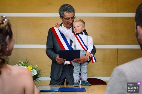 Wedding photo from Grenoble ceremony with a couple and a small boy as officiant