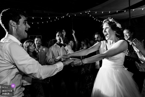 Wells, Maine wedding shoot with a couple spinning on the dance floor in black and white