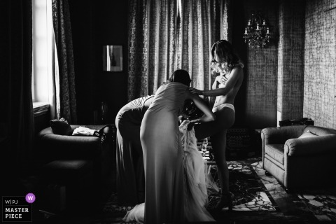 Wedding photographer Rome | Bride Getting ready and into her dress