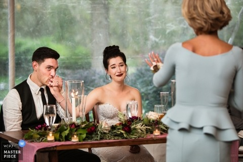 image of a New Jersey bride and groom during the parent reception speeches