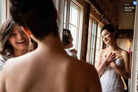 image of a New Jersey bride having a conversation with a bridesmaid