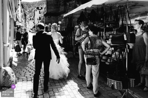 bride and groom walking in the street after wedding in France