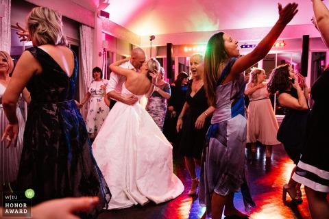 Carlowrie Castle, Edinburgh wedding shoot with a couple kissing on the dancefloor during reception