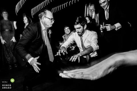 Documentary wedding photography of dancing guests at Ponferrada, Spain