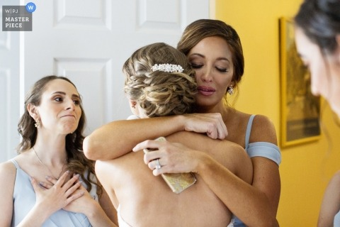 maid of honor hugs bride as emotional bride looks on for Shadowbrook at Shrewsbury NJ Wedding