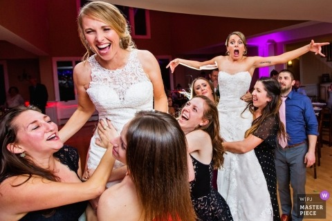 brides get raised up in the air during Rock Island Lake Club NJ Wedding