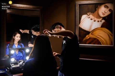 Wedding shoot with Hangzhou City bride getting hair done with lights and mirror