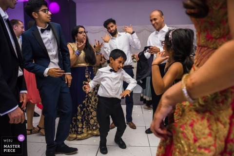 Hilton Syon Park, UK | Young boy dancing at wedding reception