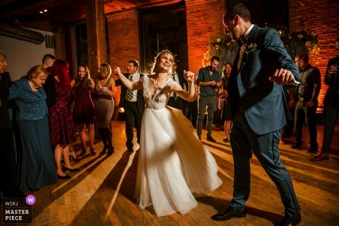 Wedding pictures of the couple on the dancefloor by Queens photographer