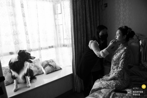 Guangdong wedding photo of bride getting make up | wedding photography in China
