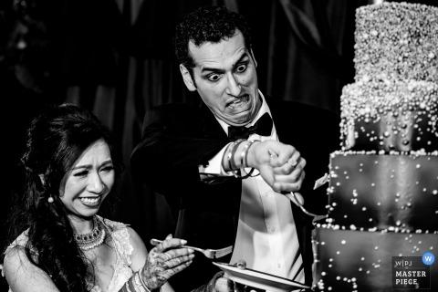 Sacramento wedding reception photograph of a CA couple cutting their wedding cake