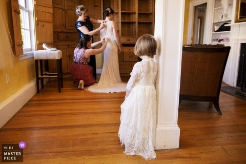 Cohasset, Mass wedding photography of little girl watching bride getting ready