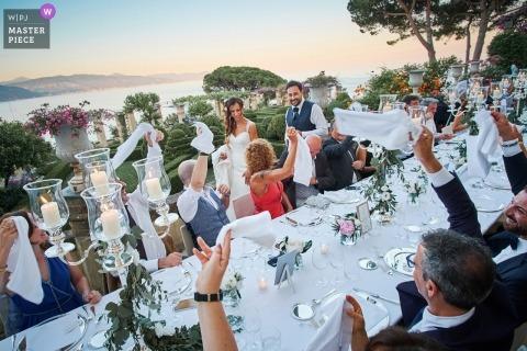 bride and groom making their entrance into the wedding reception | Portofino, Italy wedding photographers