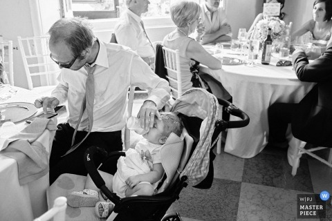 parenting during wedding reception with a baby and bottle in Italy | the hard work of parenting at weddings