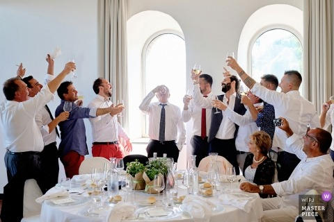 drinking games during wedding reception | father of groom into drinking games during Savona wedding reception