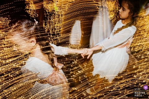 slow shutter Wedding photograph of girls at reception | Wedding day moments captured in Brasilia