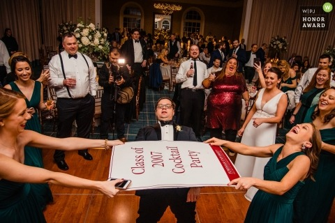 Wedding pictures of reception limbo by Queens photographer