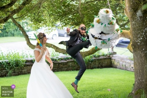 Brympton House in Somerset | Wedding Photography of a Cake Pinata with the Bride and Groom
