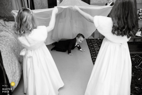 Thornbury Castle near Bristol | Wedding Photography of kids playing under the dress