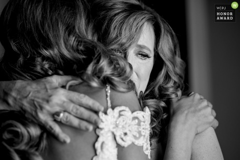Anderson, SC wedding photography - Mother of bride crying while hugging bride