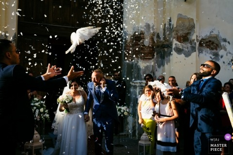 Wedding photograph captures dove being released after ceremony in Palmi-Calabria