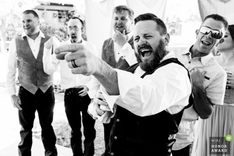 Documentary wedding photography of groom and guys at Thompson Falls, Montana reception