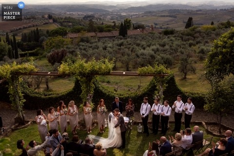 Florence couple kissing during the outdoor wedding ceremony