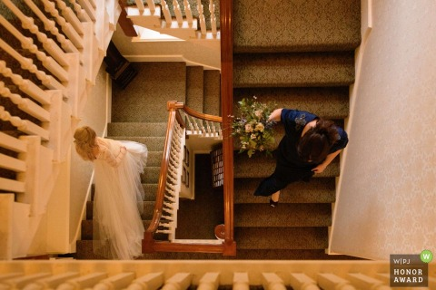Wedding photo shoot in Waterford Castle - Bride and the Downward Spiral stairs