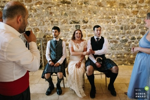 Wedding shoot at Colstoun House with Haddington couple sitting during speeches