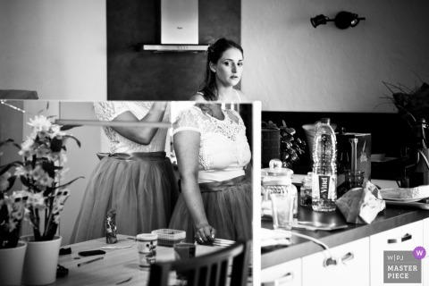 Auvergne-Rhone-Alpes wedding photography of mirros in the kitchen during the getting