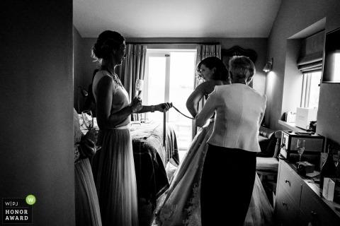 Wedding photos of bridal prep in Bartholomew Barns