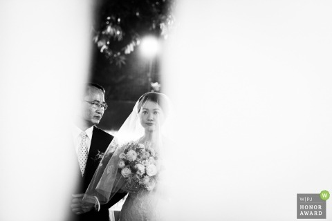Hong Kong wedding photograph of Dad lead march in with bride