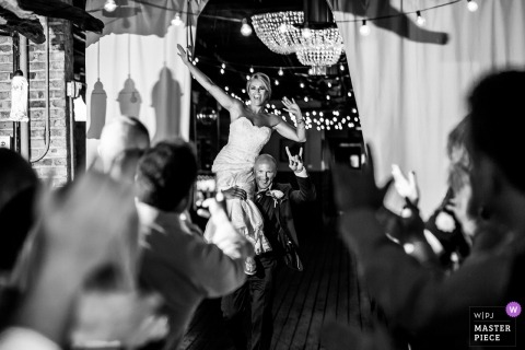 wedding reception photograph of bride and groom entering room in Chicago, Illinois
