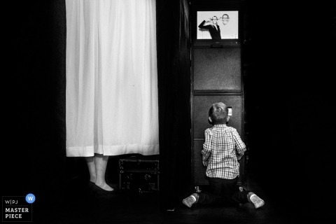 Wedding photograph of boy at photo booth in fantasy Farms toronto  | Wedding day moments from Ontario, Canada