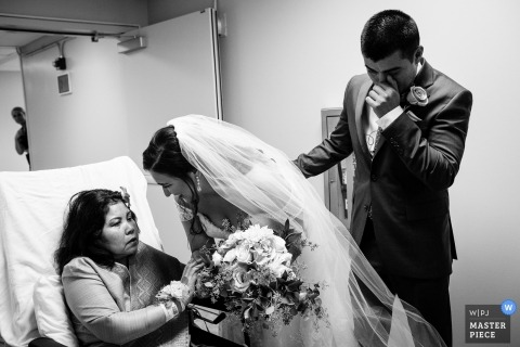 Wedding photograph of bride and groom visiting hospital | Wedding day moments captured in Saratoga Springs, Ca