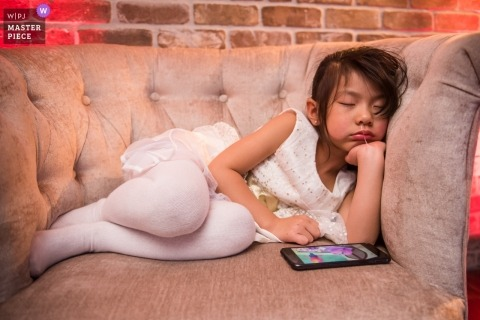 Wedding photograph of flower girl sleeping during reception | Wedding day moments captured in San Francisco, Ca